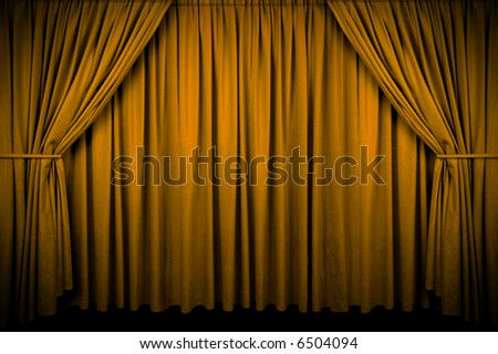 Large golden curtain with spot light and fading into dark.