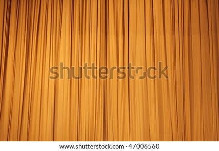 Large golden stage curtain - stock photo