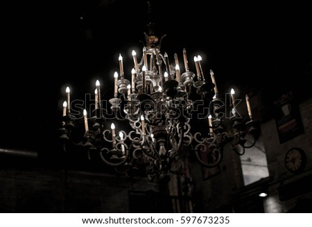 large gothic antique candle chandelier hanging from ceiling - Gothic Chandelier Stock Images, Royalty-Free Images & Vectors