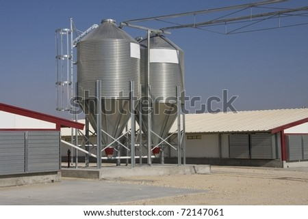 Large grain silos on farm - stock photo