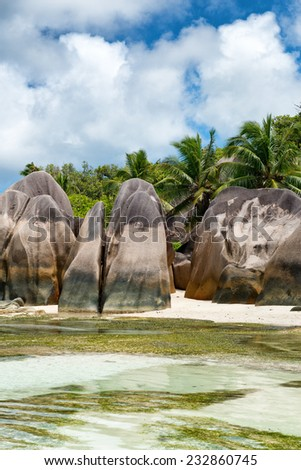 Large Granite Rocks at the Side of Striking Clear Water Lagoon of Anse Source d'Argent, the Untouched Tropical Paradise in Seychelles Islands. - stock photo
