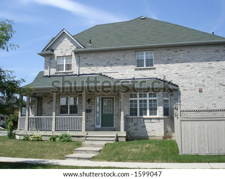 Large grey brick house