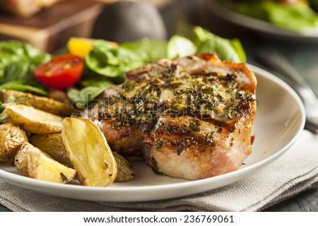 Large Grilled Pork Chop with Basil Lemon Seasonings - stock photo