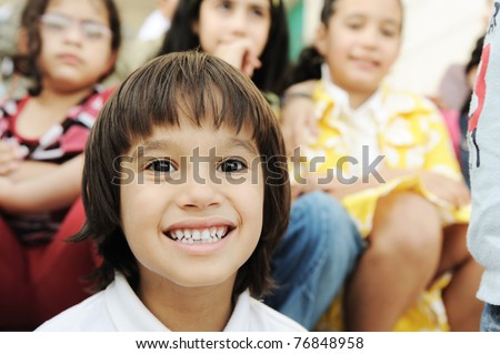 Large group, crowd, lot of happy children of different ages, summer outdoor sitting - stock photo