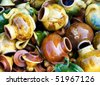 Large group of a colorful ceramic teapots. The simple form, glazed surface, shining colors. Good for background.Israeli flea market. - stock photo