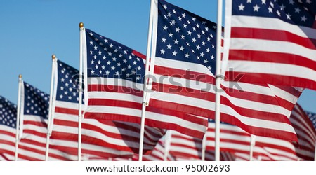 Large group of American Flags commemorating a national holiday, veterans day, independence day, 9/11, etc - stock photo