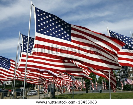 large group of american flags waving in wind