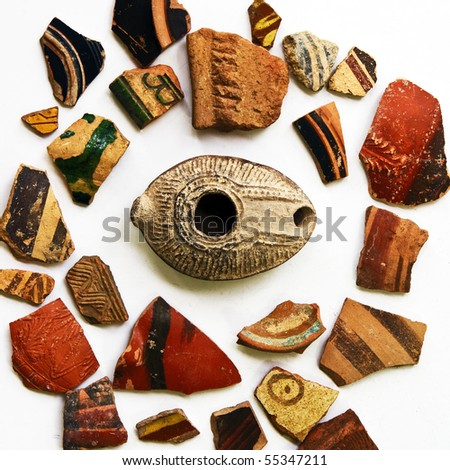 Large group of ancient colorful ceramic artifacts from different epochs of Israel history. Isolated on white. Good for background. - stock photo