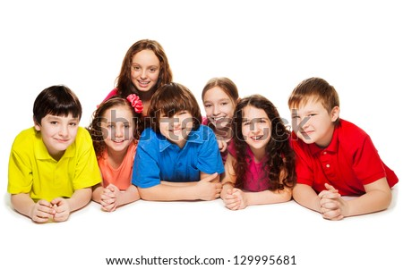 Large group of boys and girls laying on the floor together, smiling and happy, isolated on white - stock photo