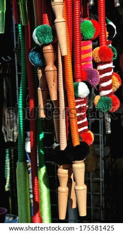 Large group of bright colorful woven pipes for a hookah. Good for decorative background. Tel Aviv flea market. - stock photo