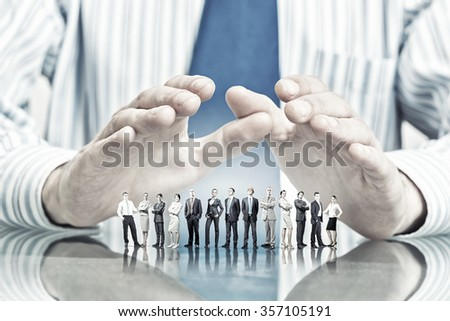 Large group of business people protected with hands  - stock photo
