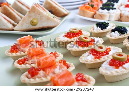 large group of canapes and sandwiches with seafood
