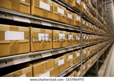 Large group of cardboard boxes in a warehouse - stock photo