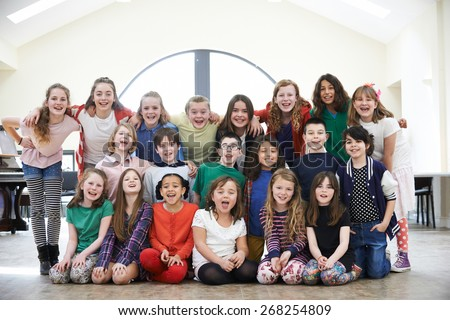 Large Group Of Children Enjoying Drama Workshop Together - stock photo