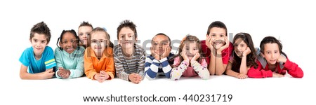 Large group of children posing isolated in white