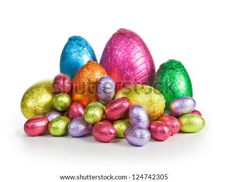 Large group of chocolate candy Easter eggs wrapped in foil - stock photo