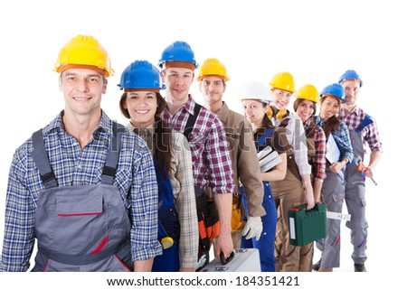 Large group of construction workers or workmen and women queuing up in a long line carrying their tool kits as they wait to clock in or be hired for a job  isolated on white - stock photo