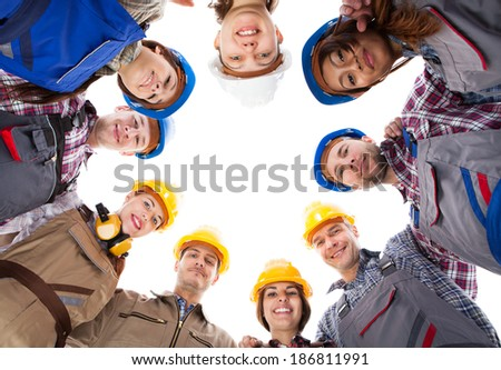 Large group of construction workers standing in circle. Isolated on white - stock photo