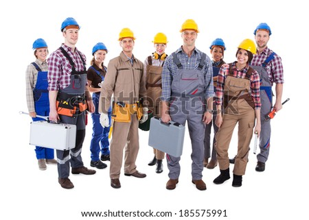 Large group of diverse workmen and women standing isolated on white - stock photo