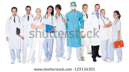 Large group of doctors and nurses. Isolated on white - stock photo
