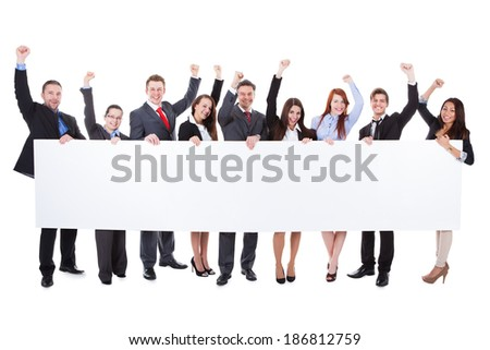 Large group of excited businesspeople presenting empty banner. Isolated on white - stock photo