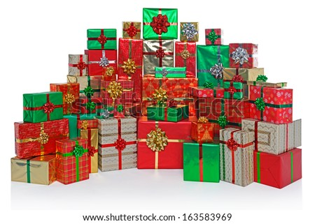 Large group of gift wrapped Christmas presents isolated on a white background. - stock photo