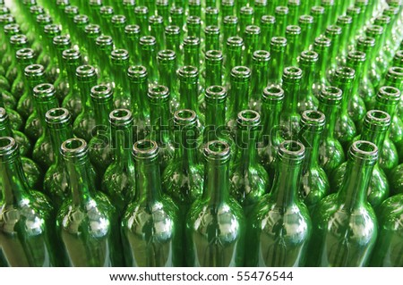 Large group of green recycled glass wine bottles - stock photo