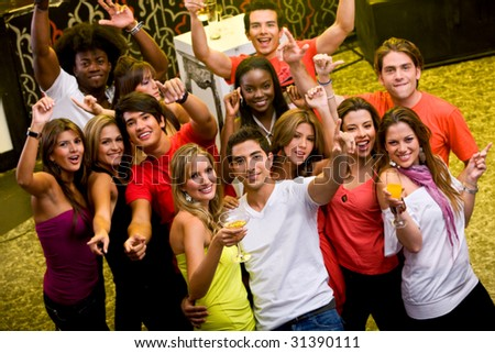Large group of happy friends at a bar or a nightclub - stock photo