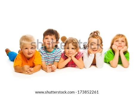 Large group of happy little kids inlaying isolated on white - stock photo