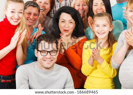 Large Group of Happy People smiling and clap their hands. - stock photo