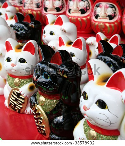 Large group of Japanese beconing cat statues - stock photo