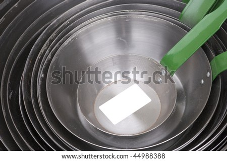large group of metal cooking pans - stock photo