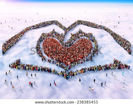Large group of people gathered together as two hands holding a heart symbol standing above the clouds - stock photo