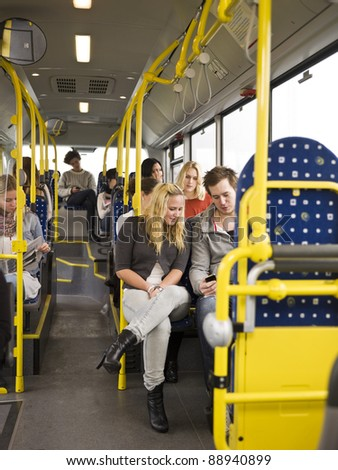 Large group of People going by bus - stock photo