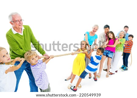 Large Group of People Pulling Rope - stock photo