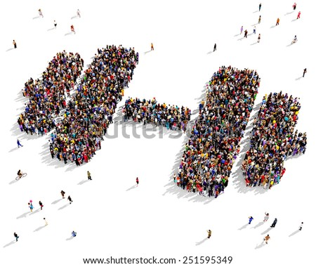 Large group of people seen from above gathered together in the shape of a dumbbell - stock photo