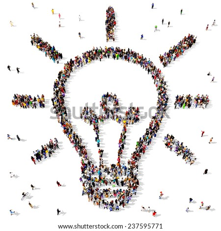 Large group of people seen from above gathered together in the shape of a light bulb - stock photo