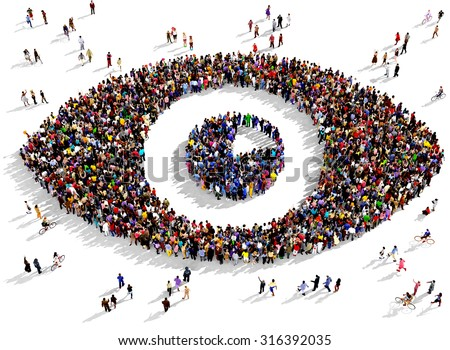 Large group of people seen from above gathered together in the shape of an eye - stock photo