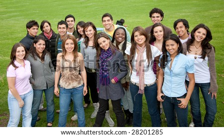 Large group of people smiling outdoors - stock photo