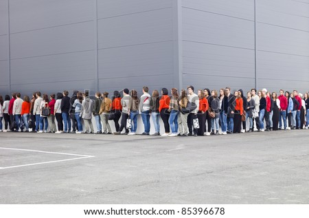Large group of people waiting in line - stock photo