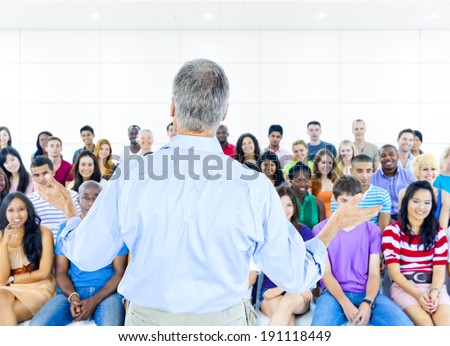 Large group of Students in lecture room - stock photo