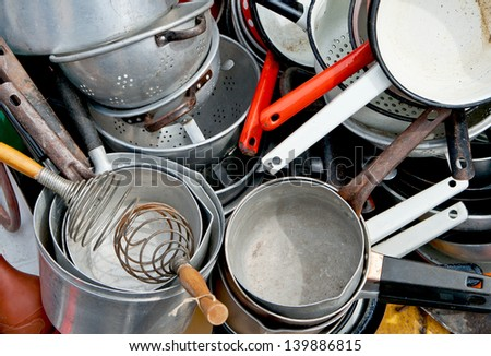 Large group of vintage colorful enameled and aluminum kitchen utensils of different types. Useful for background. - stock photo
