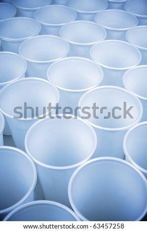 large group of white disposable plastic cups - stock photo
