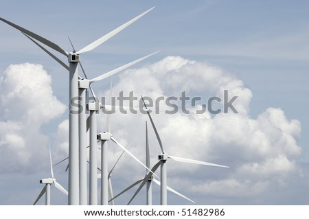large group of windmills with cloudy sky