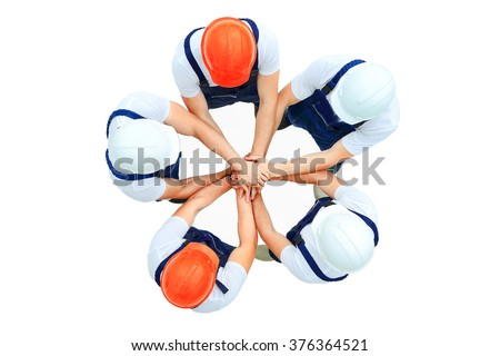 Large group of workers standing in circle - stock photo
