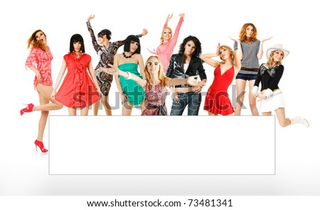 Large group of young women with white banner isolated - stock photo