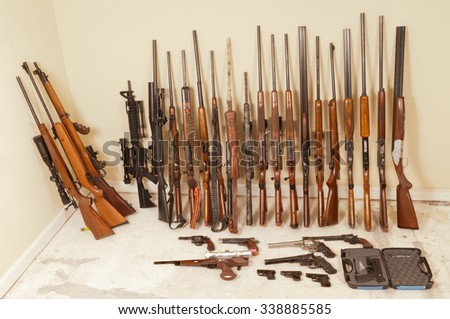 Large gun collection of rifles, shotguns, and handguns - stock photo