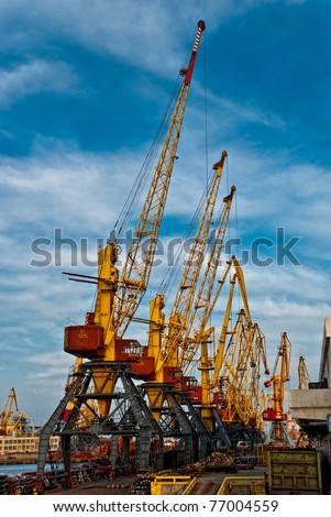 Large harbor cranes - stock photo