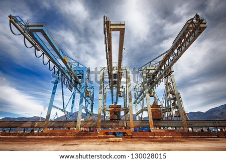 Large harbor cranes, Cranes in a seaport - stock photo