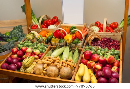 large harvest of fruits and vegetables with a blank sign - stock photo